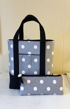 Delightful gray and off white polka dots paired with black canvas. There are 2 exterior pockets, a 3-pocket interior panel and snap closure. Best part? Special bottom insert that allows your PBT to stand up all on its own! Would you like a matching Pen Pouch? Yep, I can do that. Simply