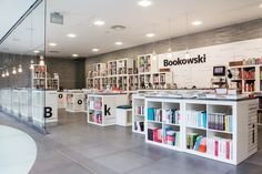 Bookowski /_ by KASIA ORWAT home design   Bookowski is a bookshop located in CK Zamek – a historic site on the map of Poznan in Poland. It's interior was designed by KASIA ORWAT home design.This interior's furnishing is based on the simplest modular shelves from IKEA, however, the cleverly arranged distribution gives them in the project a completely new form.