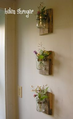From styleathome.com idea found on Pinterest. Super-easy to make! Barn board + mason jar + metal plumbing loop fastener thingamabob.