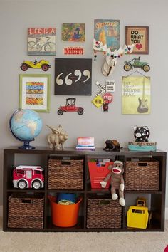 "Like: funky stuff hung on walk; use of some baskets/leaving some free space in the storage unit ""Eclectic Collectors"" boy bedroom. Again, a budget friendly shelf - it is the Expedit from Ikea. 'Looks so good with the baskets and wall art. Big Boy Bedrooms, Baby Boy Bedroom Ideas, Ikea Boys Bedroom, Guy Bedroom, Teen Bedroom, Nursery Ideas, Deco Kids, Toy Rooms, Kids Rooms"