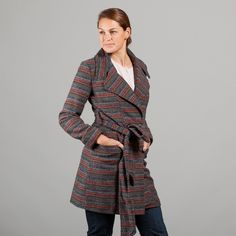 Look like you scored at you favorite thrift shop with this grey and rust stripe printed coat.