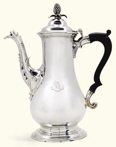 A George III silver coffee pot, John King, London, 1771 the otherwise plain baluster body engraved with a later crest and motto, pineapple finial to the hinged lid, later fibre handle