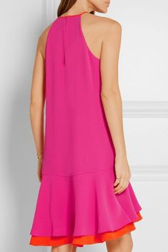 Diane von Furstenberg is adored for creating pieces that emphasize and flatter the female form. Crafted from fluid crepe, this magenta 'Kera' dress is designed with a ruffled bright-orange underlay at the hem to create movement and volume. Pair yours with gold sandals.