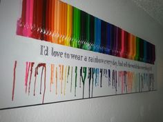 "I melted crayons in order of the rainbow and added a Johnny Cash quote from ""Man in Black"".  I used 2″ painters tape, melted the crayons and while it was still a little soft I pulled it up."