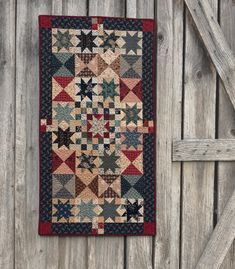"""Blue stars, both dark and light, sparkle across the surface of this patriotic """"Union Star"""" quilt."""