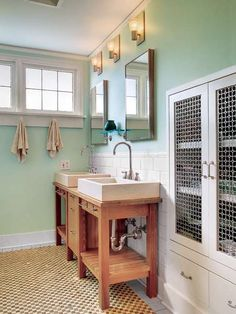 vintage style bathroom with tile floor and hemlock green painted walls, hemlock green from pantone color of month may 2014