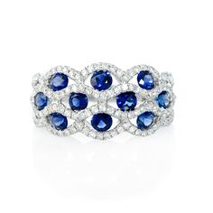NEW: Diamond ring showcasing ten round cut blue sapphires of exquisite color, nestled within accenting white diamonds and 18k white gold. #love #jewelry #trends