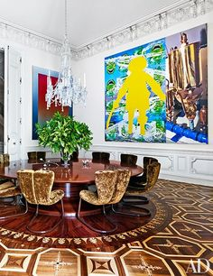Works by Rob Pruitt and Jeff Koons enliven the dining room, where the parquet floor is based on one in St. Petersburg's Pavlovsk Palace | archdigest.com