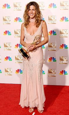 Jennifer Aniston wears a vintage Christian Dior dress at the 2002 Emmy Awards