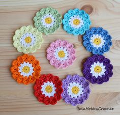 9 (nine) crochet flowers in rainbow colors.  Diameter approximately 5.5 cm (2 1/4 inches)  Made from a lovely soft 100% cotton crochet thread in
