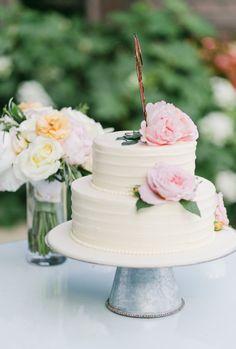 Pretty peony topped cake: http://www.stylemepretty.com/california-weddings/aptos/2015/08/31/rustic-elegant-outdoor-wedding-at-devine-ranch/ | Photography: Bluella - http://bluella.com/