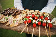 for a more interesting display, use wooden trays for canapes. it's rustic but chic and can really showcase the food.