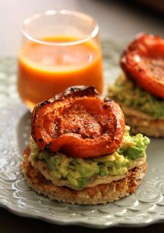 Avocado toasts with hummus & roasted tomatoes..