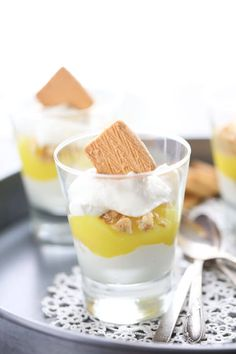 A simple and quick white chocolate mousse surround a lemon pie filing is all that is needed to make these luscious parfaits! lemonsforlulu.com
