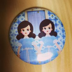 A great gift from a funny friend: The twins in The Shining ... but in cartoon form and a pin badge