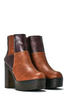 This boot comes in vegan leather and features a multicolored patchwork  design 2e264f28faa3
