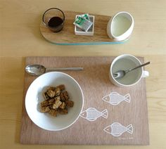 Breakfast setting with a plywood placemat and wooden kitchen board.| www.princespier.com/blogs/princespier Breakfast Set, Kitchen Board, Homewares Online, Wooden Kitchen, Mosaic Patterns, Placemat, Cushion Covers, Plywood, Tea Towels