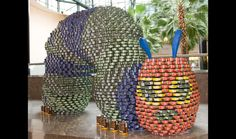 The Hungry Caterpillar, made completely out of cans! Very creative!
