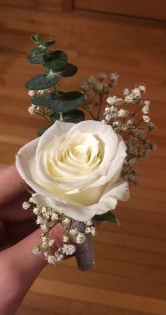 eucalyptus, white rose, and baby's breath boutonnière