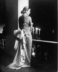 Mme. Jacques Fath wearing dress designed by her husband for their American tour.  Date taken:	1948