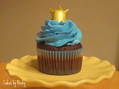 Chocolate cupcake with vanilla buttercream icing and a golden hand formed gum paste crown for a Prince-themed First Birthday party ;)