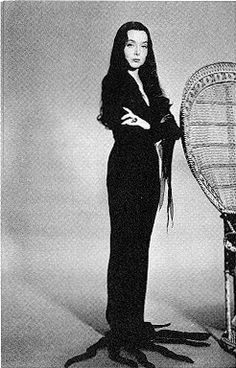 Morticia Addams. I am sad that she didn't have a different dress everyday. It would have been like an anti-barbie dress collection.