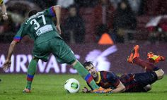FC Barcelona's Cesc Fabregas, right, duels for the ball against Elche's Lamarasa during a Copa del Rey soccer match at the Camp Nou ...