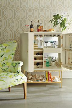 What better way to entertain friends on the weekend than with the Lacquered Bar Cabinet from Anthropologie?