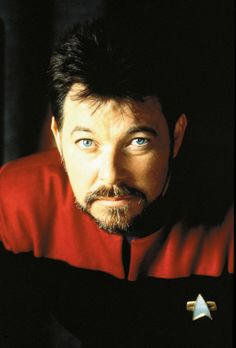 Jonathan Frakes as William T. Riker.