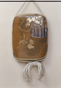 Inrô, Shibata Zeshin, born 1807 - died 1891 (maker), 1865 (made), Gold and silver hiramakie and takamakie on a gold lacquer ground, inlaid with pearl-shell, Victoria and Albert Museum.