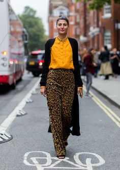 Wear a pair of oversized leopard print trousers with a brightly coloured shirt and duster coat like Giovanna Battaglia.