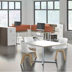 Seven desks and tables outfit individual and group environments alike.