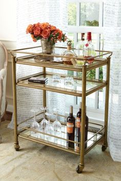 Burgundy Bar Cart - Brass Cart, Bar Cart, Mirrored Bar Cart   Perhaps you could park a bar cart or tea tray in that little corner between the kitchen and LR. It would be functional for taking things into the dining room or hosting a tea with L!