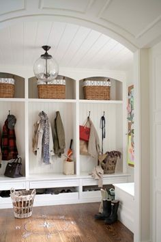 Elegant mudroom in coastal style home - note the compass in wood floor, and barrel ceiling entry...