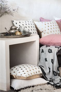 Keep it cosy with cushions and home decor in warm pastels and poetic prints! Take to look to the next level with tassels and Morroccan-inspired prints. | H&M Home