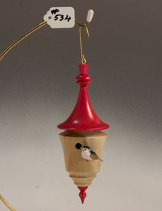 Wooden hanging birdhouse with blue bird / Christmas ornament. 18.00, via Etsy.