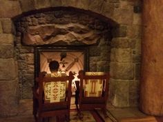 A cozy fireplace right inside the lobby at the DVC Villas at Wilderness Lodge. http://www.allears.net | #DVC #WDW #WaltDisneyWorld #LuxuryResorts #DisneyVacationClub #Holidays