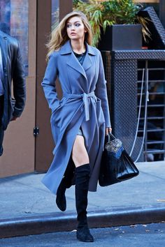 Gigi Hadid street style with long coat and over-the-knees suede boots.