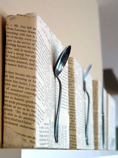 Get old cookbooks from thrift store and rip up the pages, mod podge to cardboard box, and add silverware. Cute for kitchen