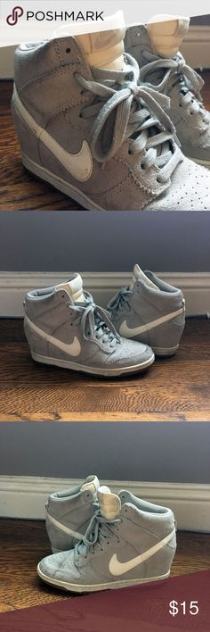 Nike Dunk Sky Hi Wedge Sneakers 6.5 in Grey/White Popular version of the classic Dunk style in grey and white suede. Looks as good with jeans as it does with a dress.  The surface is scuffed in parts on the heel and toe. I've tried to clean as much as I can but the pair can definitely use a suede cleaning. Please see pictures for reference. Nike Shoes Sneakers