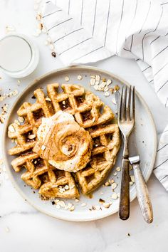 These Flourless Peanut Butter Waffles are not only easy to make, but also protein rich! All you need are a few healthy ingredients and they turn out light, fluffy, dairy free, and delicious! Freezable for breakfast meal prep or on simple grab and go! Truly one of our favorite waffle recipes!