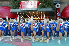 Cheerleaders are a much a Macy's Thanksgiving Day Parade tradition as giant balloons. This group was alive and kicking in front of Macy's flagship store during the 2002 parade.