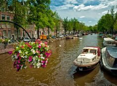 Amsterdam is another place that's worth packing an extra sweater on your springtime visit.The weather in May is beautiful and the air is sweet with the scent of the blooming trees and tulips the city is known for.