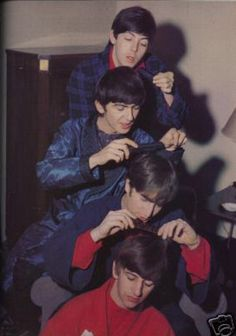 The Beatles give each other haircuts...  We love them Yea yea yea yea!
