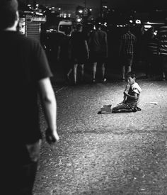 Smooth melody of poverty - On the street of Istanbul, beggar kid is playing on his musical instrument for money.