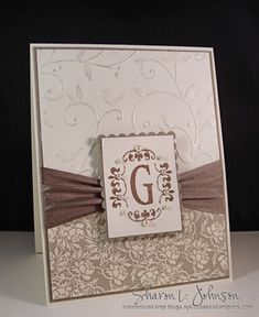 embossed top bkgrd, DSP on bottom, ribbon between, make monogram stand out.  would be nice as set for a holiday gift