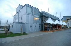 shipping container restaurant design | ... shipping containers to pay homage to the quays' industrial marine
