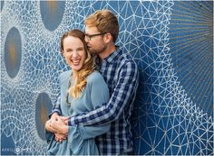 A happy moment during and engagement session with a pretty blue mural by Gemma Danielle in Denver Colorado. - April O'Hare Photography http://www.apriloharephotography.com