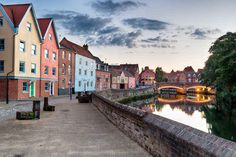The pastel and red brick townhouses overlooking the River Yare at Norwich in Norfolk in England: