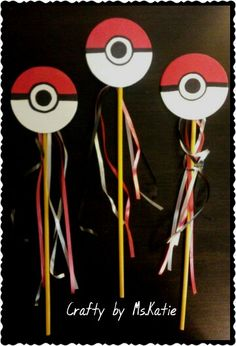 Pokewands : Pokemon pokeball wands I made as party favors for my sons birthday party. I painted pokeballs onto wooden circles I found at the craft store then hot glued them onto craft sticks and added ribbon.*Ms.Katie*